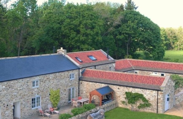 trio of yorkshire barns with hot tubs